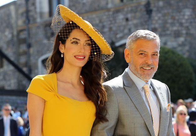 Mariage de Meghan et Harry  Amal, en robe jaune et chapeau et George  Clooney
