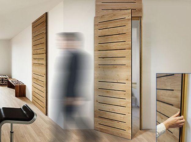 L 39 inspiration du jour une porte sans poign es elle for Isoler une porte du bruit