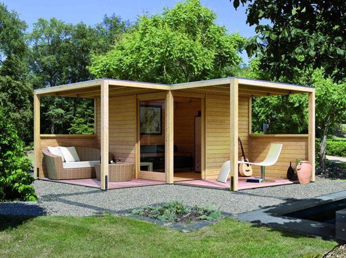 24 abris pour votre jardin abris de jardin elle d coration for Moulin en bois pour jardin