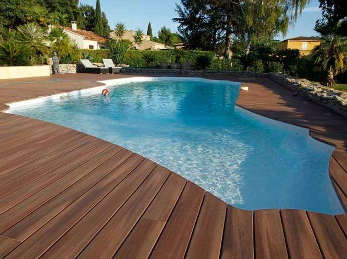 une piscine pour tous les styles elle d coration. Black Bedroom Furniture Sets. Home Design Ideas