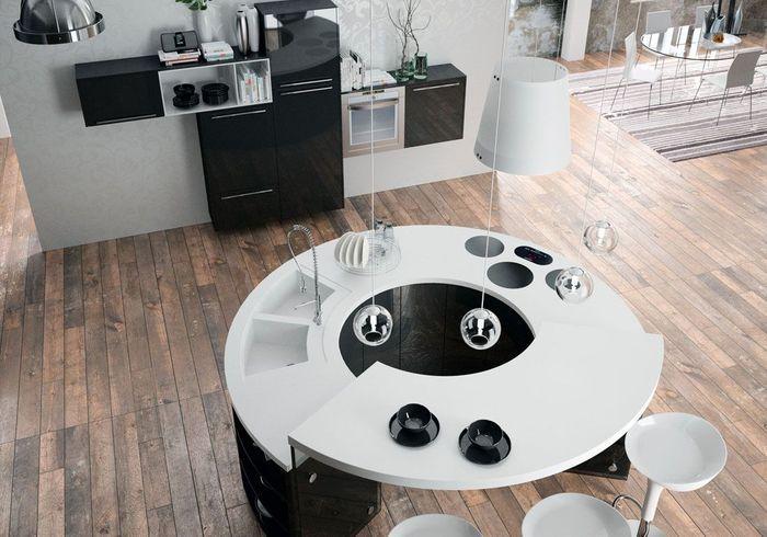 Cuisine noire et blanche qui change grâce à un îlot circulaire